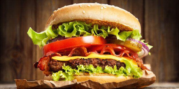 Delicious hamburger on wooden