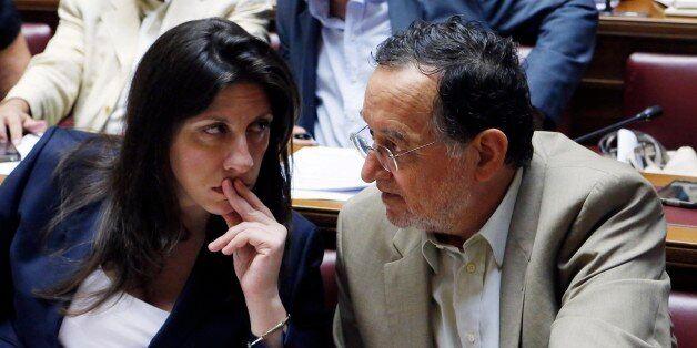 Parliament speaker Zoe Konstantopoulou, left, speaks with Energy Minister Panagiotis Lafazanis during...
