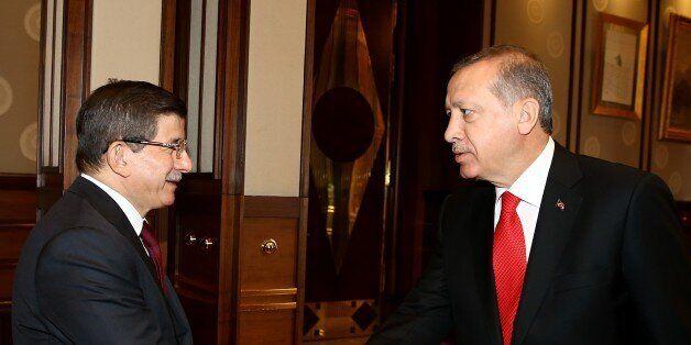 ANKARA, TURKEY - AUGUST 25: Turkish President Recep Tayyip Erdogan (R) and Turkish Prime Minister Ahmet...