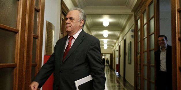 Greece's Deputy Prime Minister Giannis Dragasakis arrives for a cabinet meeting at the parliament in...