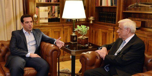 Greek Prime Minister Alexis Tsipras (L) talks to the President of the Greek Republic Prokopis Pavlopoulos...