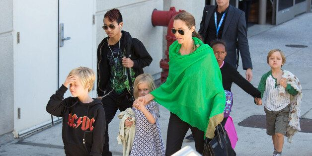 LOS ANGELES, CA - FEBRUARY 05:  Angelina Jolie is seen after landing at Los Angeles International Airport with her children, Maddox Jolie-Pitt, Shiloh Jolie-Pitt, Vivienne Jolie-Pitt, Zahara Jolie-Pitt and Knox Jolie-Pitt on February 05, 2014 in Los Angeles, California.  (Photo by GVK/Bauer-Griffin/GC Images)