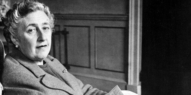English writer Dame Agatha Christie, poses in March 1946 for a photographer holding a notebook, in her...