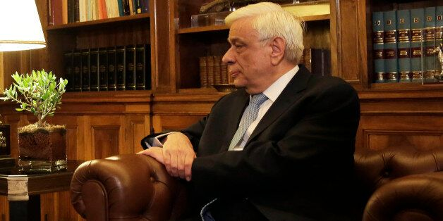 Greek Prime Minister Alexis Tsipras , left, speaks with Greek President Prokopis Pavlopoulos, during...