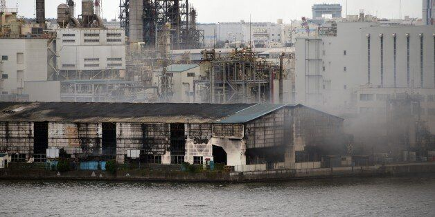 Smoke rises from a steel plant beside a river in Kawasaki near Tokyo's Haneda airport on August 24, 2015....