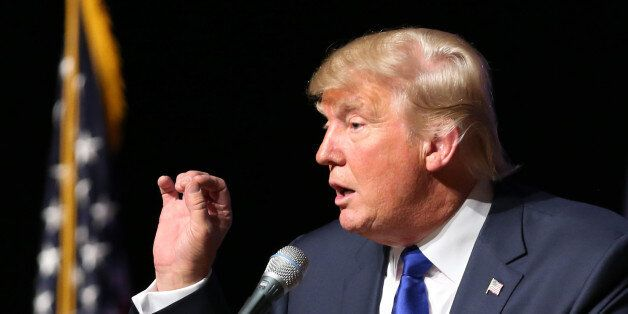 Republican presidential candidate businessman Donald Trump speaks to an audience during a town hall event,...