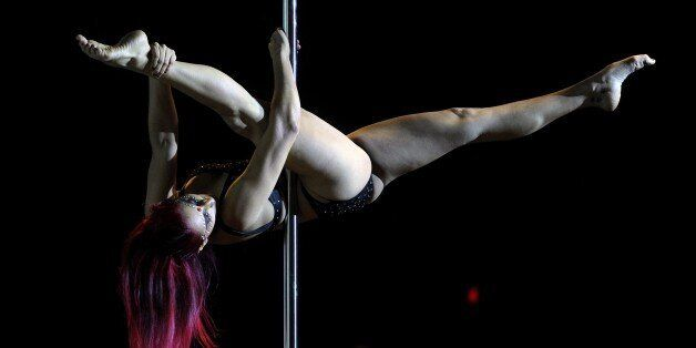 Argentine pole dancer Florencia Forquera competes in the Argentina Amatuer 2014 Pole Dance competition...