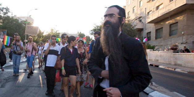 Ultra-Orthodox Jew Yishai Schlissel walks through a Gay Pride parade and is just about to pull a knife...