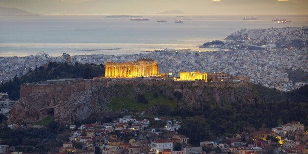 Athens, Greece. After sunset. Parthenon and Herodium construction in Acropolis