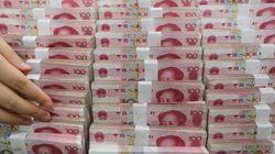 Σε υποτίμηση του γουαν προχώρησε η Κίνα για να στηριχθούν οι