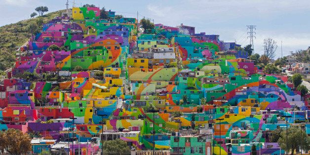In this Thursday, July 30, 2015 photo, hundreds of houses painted in bright colors in what organizers...