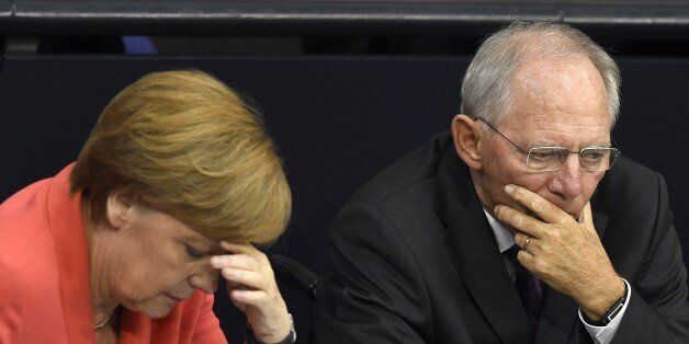 German Chancellor Angela Merkel (L) confer with finance minister Wolfgang Schaeuble during a debate in...