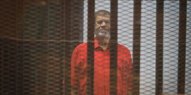 CAIRO, EGYPT - AUGUST 10: Former Egyptian President Mohamed Morsi stands inside the defendants' cage...