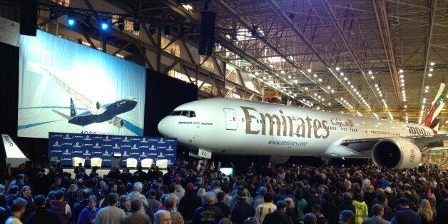 Boeing Co. employees gather to celebrate the completion of the 1,000th 777 airplane, Friday, March 2,...