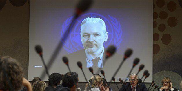 WikiLeaks founder Julian Assange is seen on a screen speaking via web cast from the Ecuadorian Embassy...