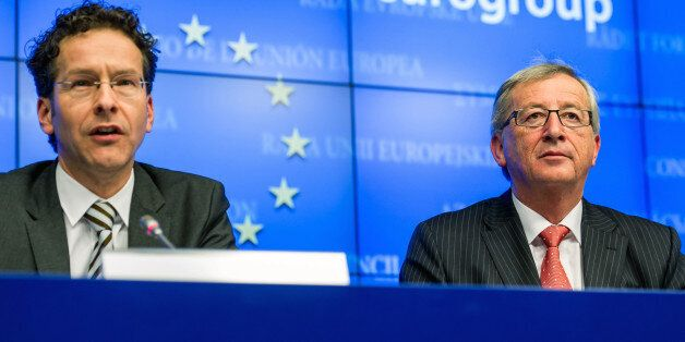 The resigning President of the Eurogroup Jean-Claude Juncker, right, sits next to the new President-elect...