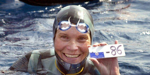 Russian Natalia Molchanova shows the minus 86 metres tag that gives her a win in the first women's free-diving...
