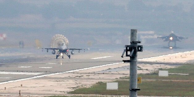 Turkish Air Force fighter planes land at Incirlik Air Base, on the outskirts of the city of Adana, southern...