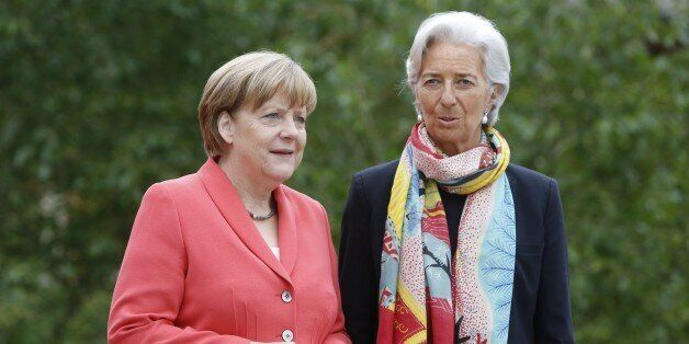 ELMAU, GERMANY - JUNE 8: German Chancellor Angela Merkel (L) greets International Monetary Fund (IMF)...