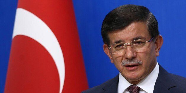 Turkish Prime Minister and leader of the Justice and Development Party (AKP) Ahmet Davutoglu holds a...