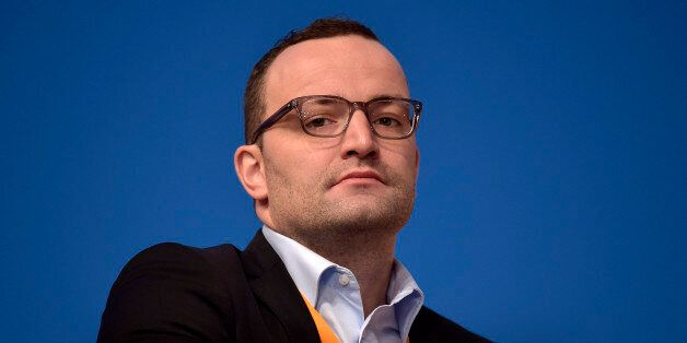 New Deputy Chairman Jens Spahn of the German Christian Democrats, CDU, watches from the podium during...
