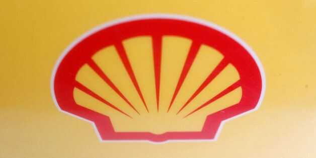 LONDON - JANUARY 31: A Shell logo is displayed at a petrol station on the day Shell announced record...