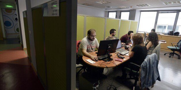 TO GO WITH AFP STORY BY SOPHIE MAKRIS -- People work in the offices of a Start-up in Athens on November...