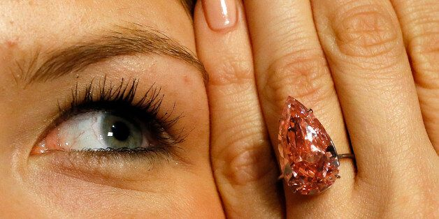 FILE - In this April 7, 2016 file picture a model displays 'The Unique Pink' the largest Fancy Vivid...