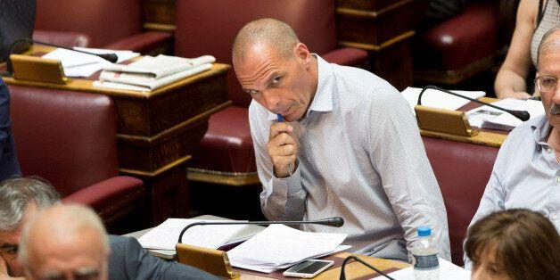 Greek former finance minister, Yanis Varoufakis , listens to the speech of Finance Minister Euclid Tsakalotos...
