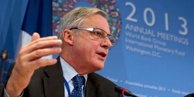 Governor of the Banque de France Christian Noyer speaks in a news conference during the World Bank/IMF...