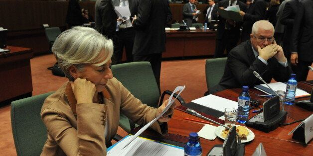 French Finance Minister Christine Lagarde (L) reviews notes while her Portuguese counterpart Fernando...