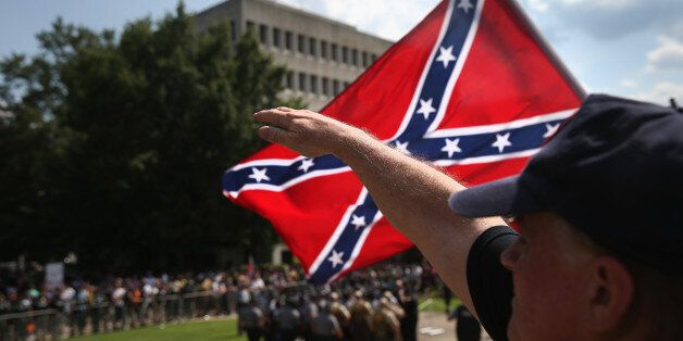 COLUMBIA, SC - JULY 18: A member of the Ku Klux Klan gives a Nazi salute as the Klan members fly the...