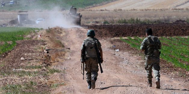 Turkish soldiers patrol near the border with Syria, ouside the village of Elbeyli, east of the town of...