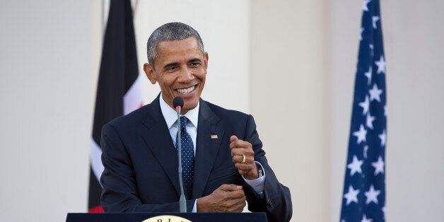 President Barack Obama makes a joke while answering a question from the media about the dinner he had...