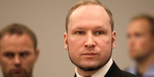 Anders Behring Breivik listens to the judge in the courtroom, Friday, Aug. 24, 2012, in Oslo, Norway....
