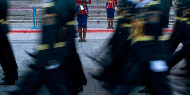 Mongolian soldiers march past honor guards during a rehearsal for a military parade during the Naadam...