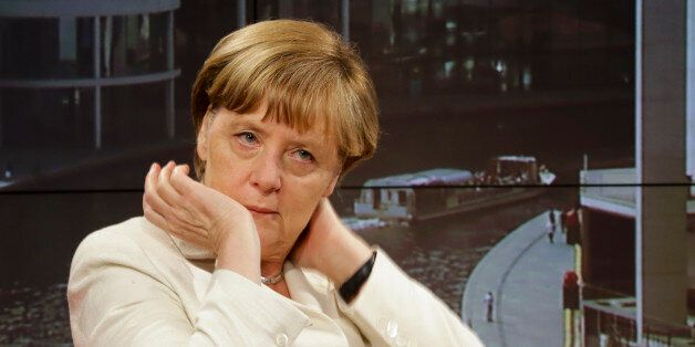 German Chancellor Angela Merkel waits prior to an interview at the studios of German public broadcaster...