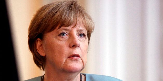 German Chancellor Angela Merkel addresses journalists during press conference in Sarajevo, Bosnia, Thursday,...
