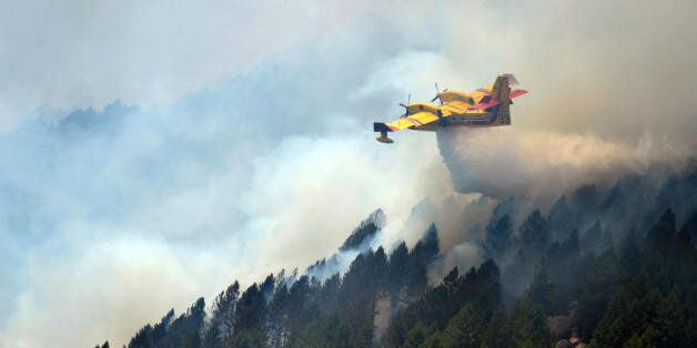 A Canadair works to extinguish fire on la Vacca mount, near the village of Aullene, Corsica, on July...