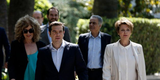 Greece's Prime Minister Alexis Tsipras, center, leaves from the Presidential Palace with the new members...