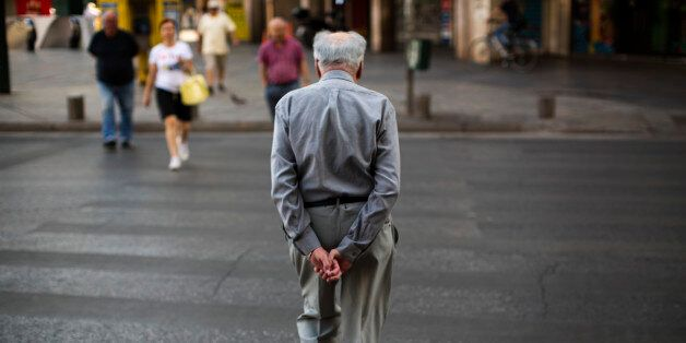 A man walks in central Athens, Monday, July 6, 2015. Greece's finance minister has resigned following...