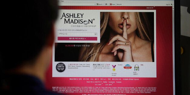 In this June 10, 2015 photo, Ashley Madison's Korean web site is shown on a computer screen in Seoul,...
