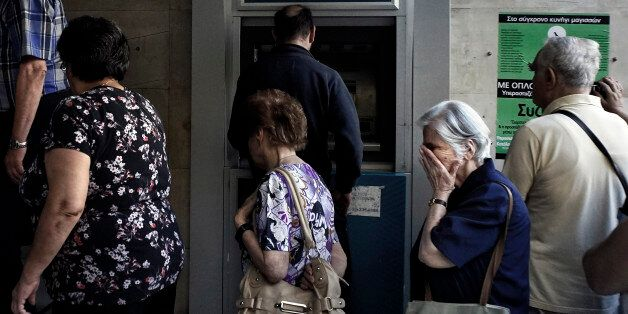 ATHENS, GREECE - JULY 2: Pensioners line up outside a National Bank branch on July 2, 2015 in Athens,...