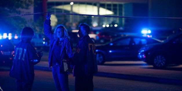 Federal investigators respond to the scene of a shooting at the Grand Theatre on Thursday, July 23, 2015,...