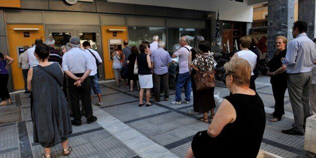 People queue at an ATM outside of a National bank branch in Thessaloniki on July 8, 2015. European leaders...