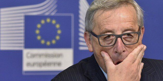European Commission President Jean-Claude Juncker gestures during a joint press with former Italian Prime...