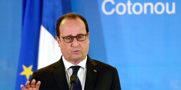 French president Francois Hollande holds a joint press conference with his Beninese counterpart at the...