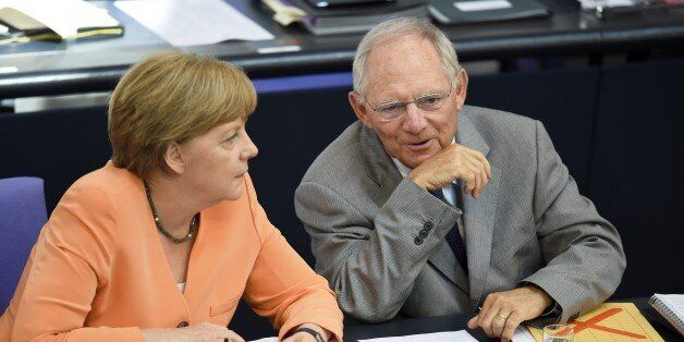 German Finance Minister Wolfgang Schaeuble (R) and German Chancellor Angela Merkel attend a session at...