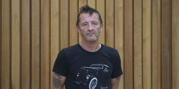 Former AC/DC drummer Phil Rudd stands in the dock as faces charges at the High Court in Tauranga, New...