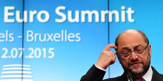 European Parliament President Martin Schulz addresses a press conference during a summit of Eurozone...